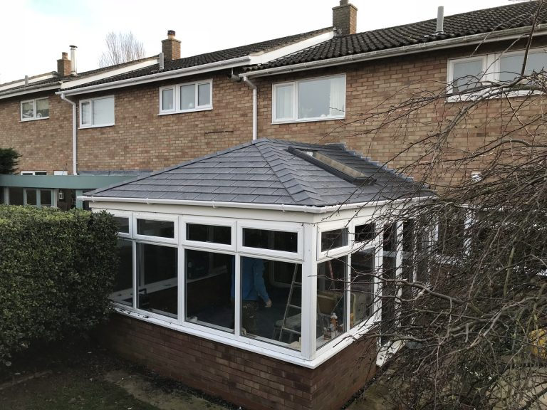 Tiled conservatory roof with a Velux window
